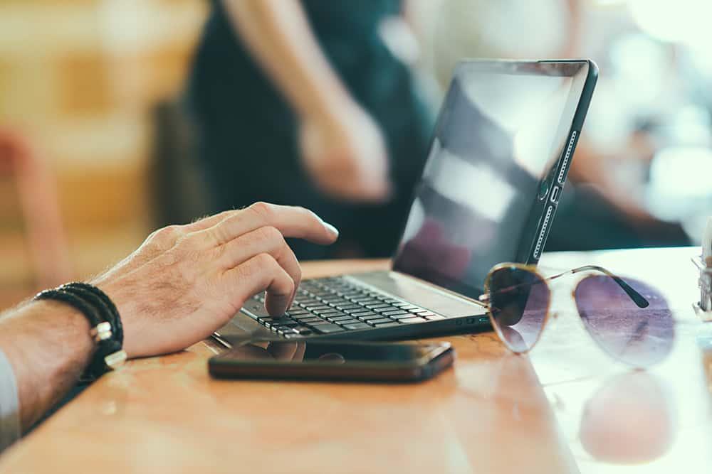 sunglasses-hand-smartphone-desk.jpg