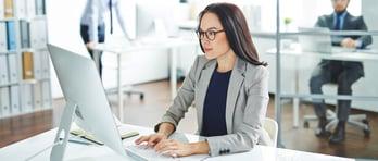 businesswoman-typing-business-summary-2