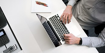 Online Email Writing Course Typing on Laptop