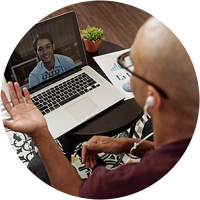 online-writing-executive-coaching-call-on-laptop-with-headphones-circle