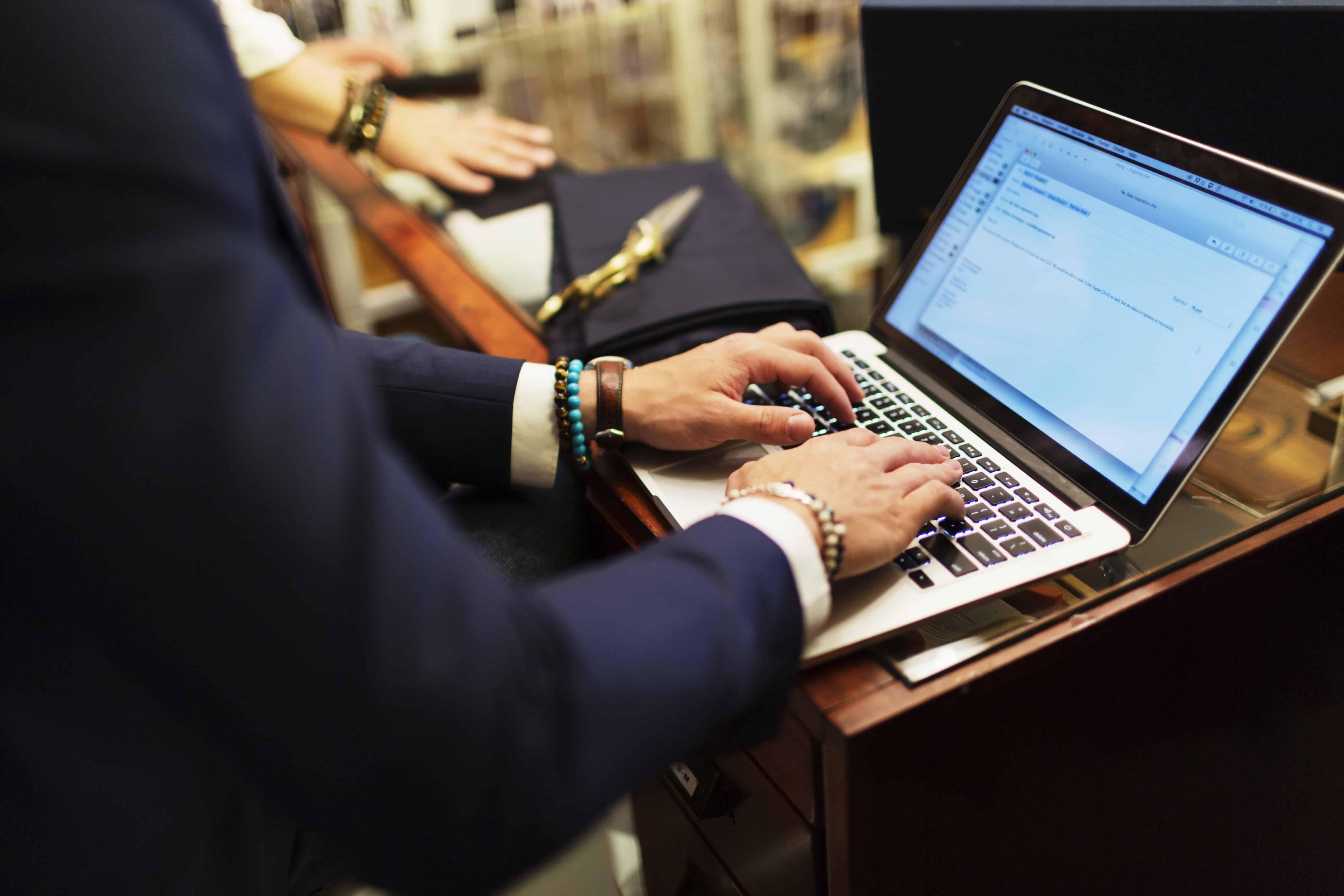 salesman-using-laptop-writing-email