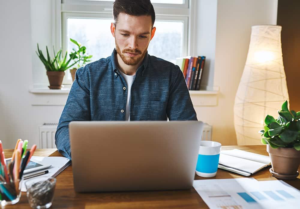 serious-man-working-on-laptop-PDLB8UA (1)-jpg