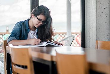 girl at desk studying