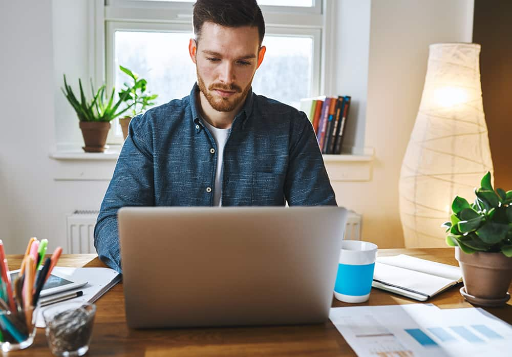 writing on laptop work training at desk